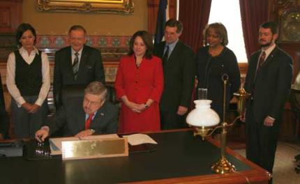 At a bill signing with Gov Branstad and other legislators.